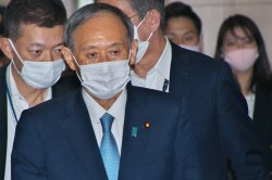 Japan's Suga sides with Hiroshima 'black rain' victims, ending long legal battle