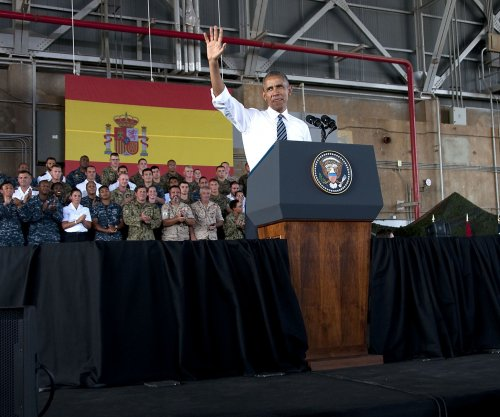 President acknowledges 'difficult week' in U.S. during abbreviated visit to Spain