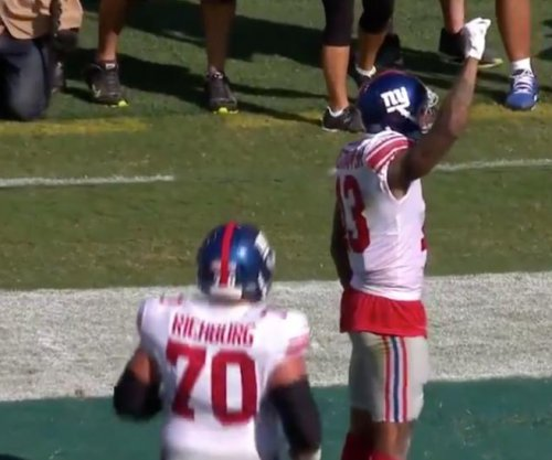 Odell Beckham Jr: New York Giants star raises fist, pretends to be peeing dog after scores