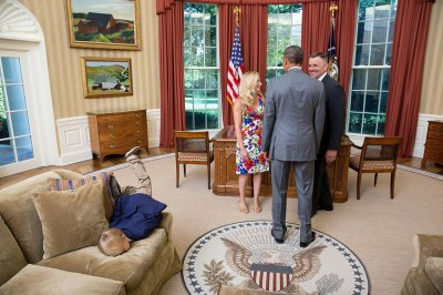 Kid bored by president face-plants into Oval Office couch