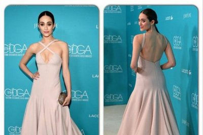 Emmy Rossum bares cleavage at 2015 CDG Awards