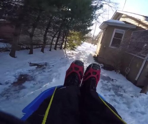 New Jersey dad builds luge track in yard