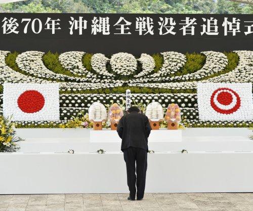 Japanese Prime Minister Shinzo Abe jeered in Okinawa