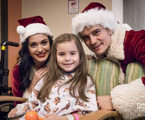 Katy Perry, Orlando Bloom dress as Mrs. Claus, Santa for hospital visit