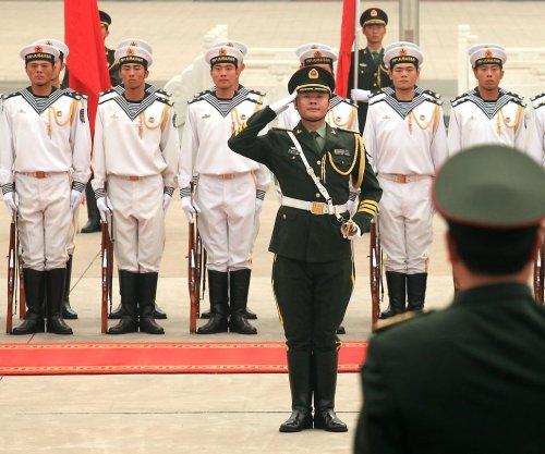 China to conduct more naval drills near Hainan Island