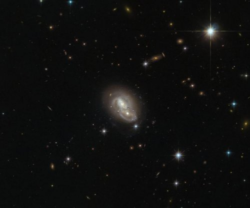 Hubble spots pair of galaxies passing at high speed