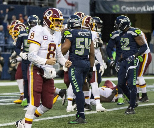 QB Kirk Cousins officially signs with Minnesota Vikings