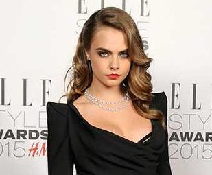Cara Delevingne bares cleavage at 2015 Elle Style Awards