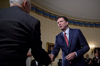 FBI director meets with top lawmakers over Trump charge of Obama wiretap