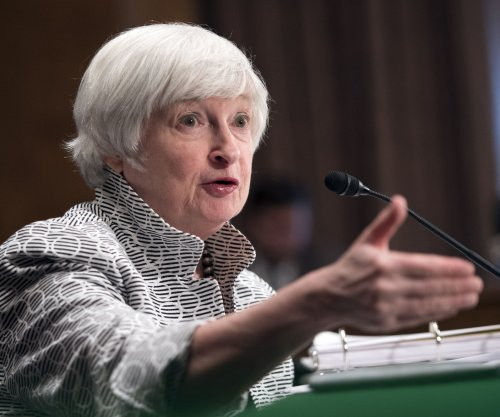 Dollar down as Federal Reserve begins policy meeting