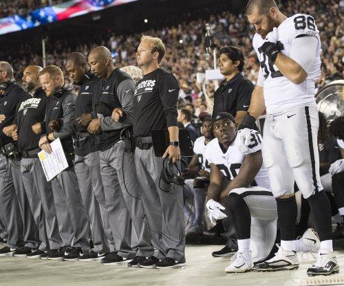 Most Oakland Raiders sit, some Washington Redskins kneel during national anthem