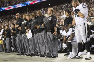 Most Oakland Raiders sit, some Washington Redskins kneel during national anthem