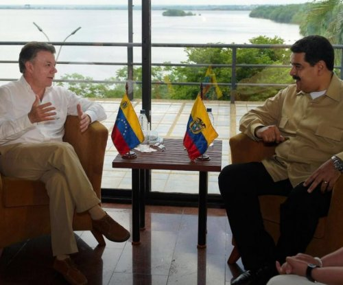 Colombia, Venezuela agree to reopen border gradually after presidents meet
