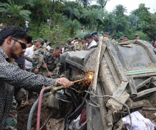 Nearly 50 dead after landslide buries 2 buses in India