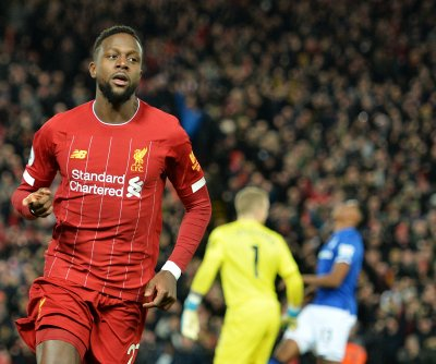 Liverpool dismantles Everton, increases Premier League lead