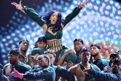 Cardi B shows off huge, floral back tattoo