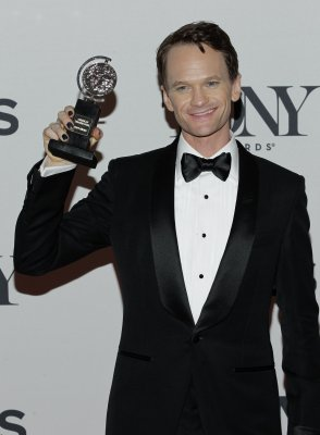 Neil Patrick Harris spits water at woman during show