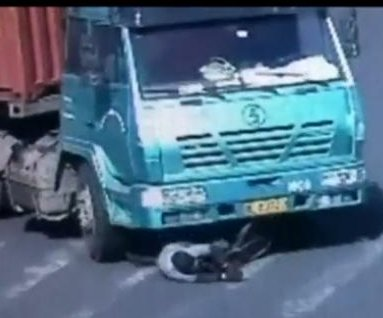 Video shows cyclist survive being run over by truck