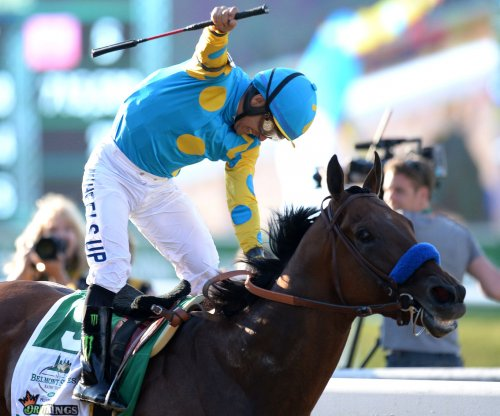 American Pharoah wins Belmont Stakes, Triple Crown