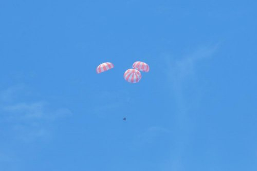 SpaceX's Dragon spacecraft parachutes back to Earth
