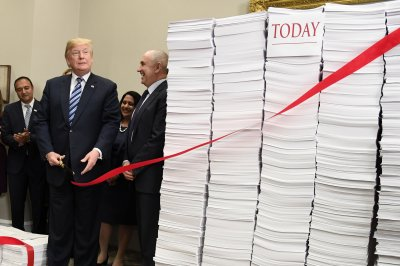 Trump boasts of cutting 'the red tape of regulation'