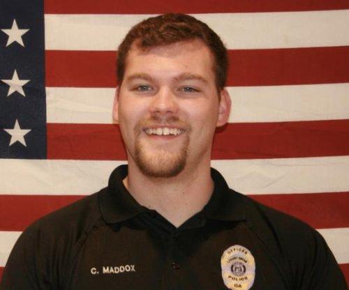 Georgia officer killed, 2 injured serving warrant
