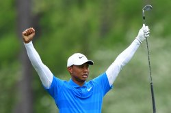 Tiger Woods holes out for eagle at Memorial