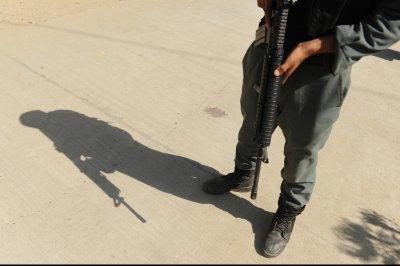 Car bomb, gunmen hit Afghan government building
