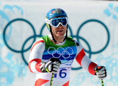 Switzerland's Cuche wins downhill title