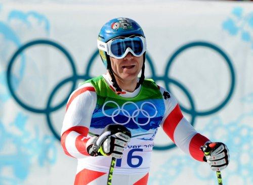Switzerland's Cuche wins downhill title