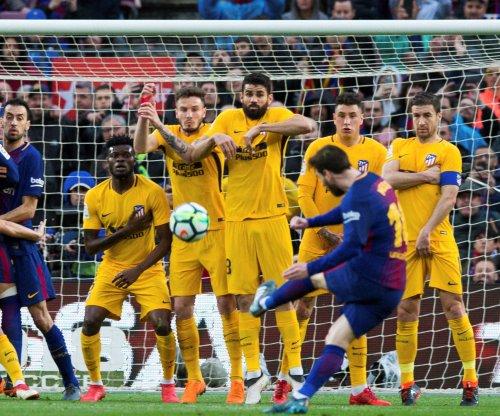 Lionel Messi nets perfect free kick in Barcelona's win vs. Atletico Madrid