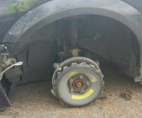 Police stop car driving with front tire missing