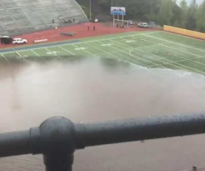 Tacoma high school stadium rapidly floods in 'epic rain storm'