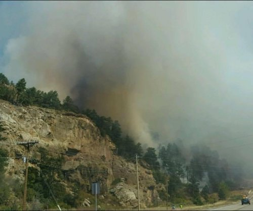 Colorado wildfire: Thousands evacuate; several homes torched; many more in danger
