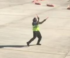 Airport worker's tarmac dance moves lead to viral stardom