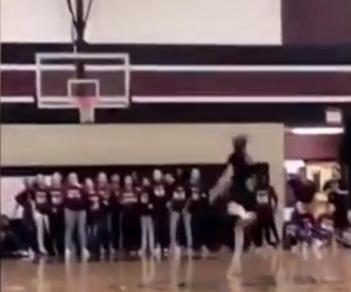 Middle schooler sinks half court shot at pep rally
