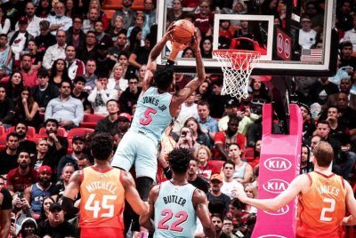 Miami Heat's Derrick Jones Jr. dunks on 7-footer Rudy Gobert