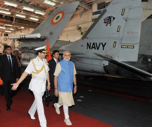 Modi meets defense chiefs aboard aircraft carrier INS Vikramaditya