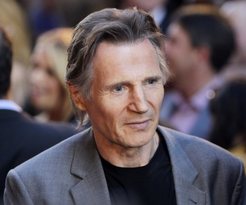 Liam Neeson romantically involved with 'famous' woman