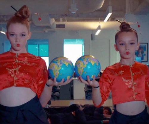 Watch two girls dance around the office to Beyonce's 'Run the World'