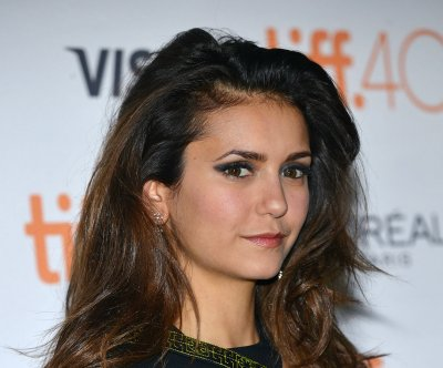 Nina Dobrev, Austin Stowell make red carpet debut