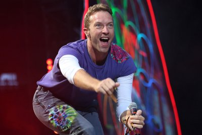 Coldplay performs in public spaces in 'Orphans' music video