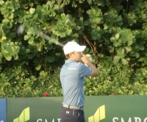 Jordan Spieth shares lead in Singapore