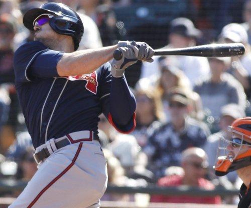 Braves' Adam Duvall gets 3-run homer converted to 2-run single