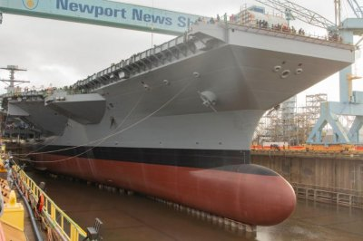Aircraft carrier John F. Kennedy meets water as HII floods dry dock