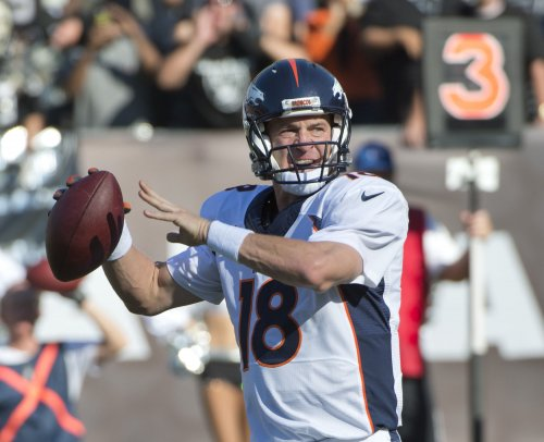 Manning throws 5 TD passes as Broncos rout Raiders