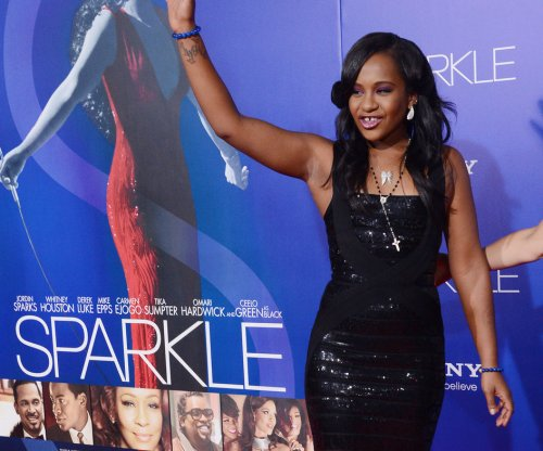 Bobbi Kristina Brown is improving and won't be brought home to die, says aunt