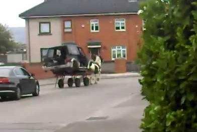 Horse-drawn SUV turns heads in Irish city