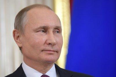 Putin accuses Obama administration of undermining Trump's legitimacy