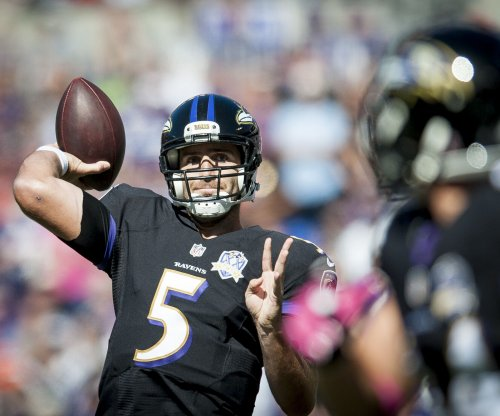 Joe Flacco throws 4 TDs as the Baltimore Ravens rout the Miami Dolphins
